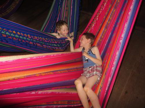 Cuyabeno Fauna Reserve Ecuador: Resting in hammocks at the Cofan Lodge when visiting the Amazon in Ecuador.
