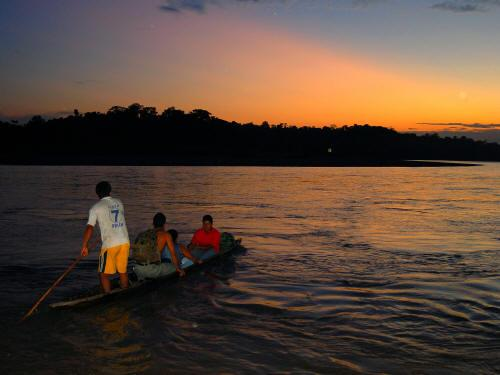 COFAN TRIBE HISTORY: Canoeing into the sunset.